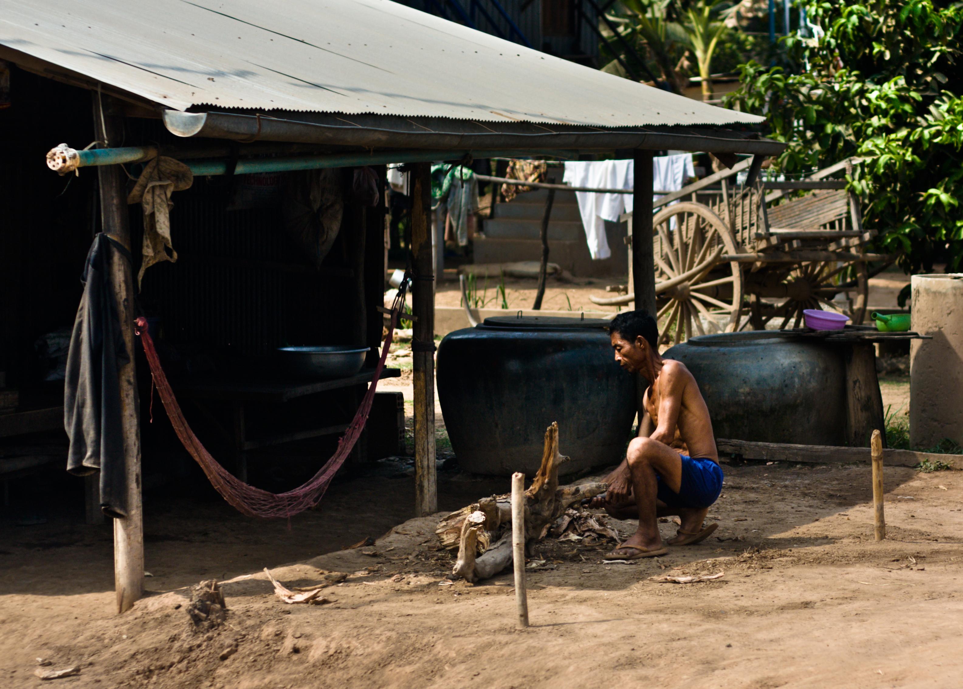 Khmer man cutting wood