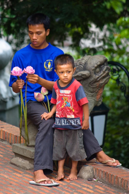 Boys Selling Lotus Flowers at Wat Phnom