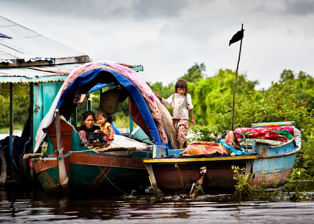 Houseboat on the Tonle Sap Cambodia with Little Girl