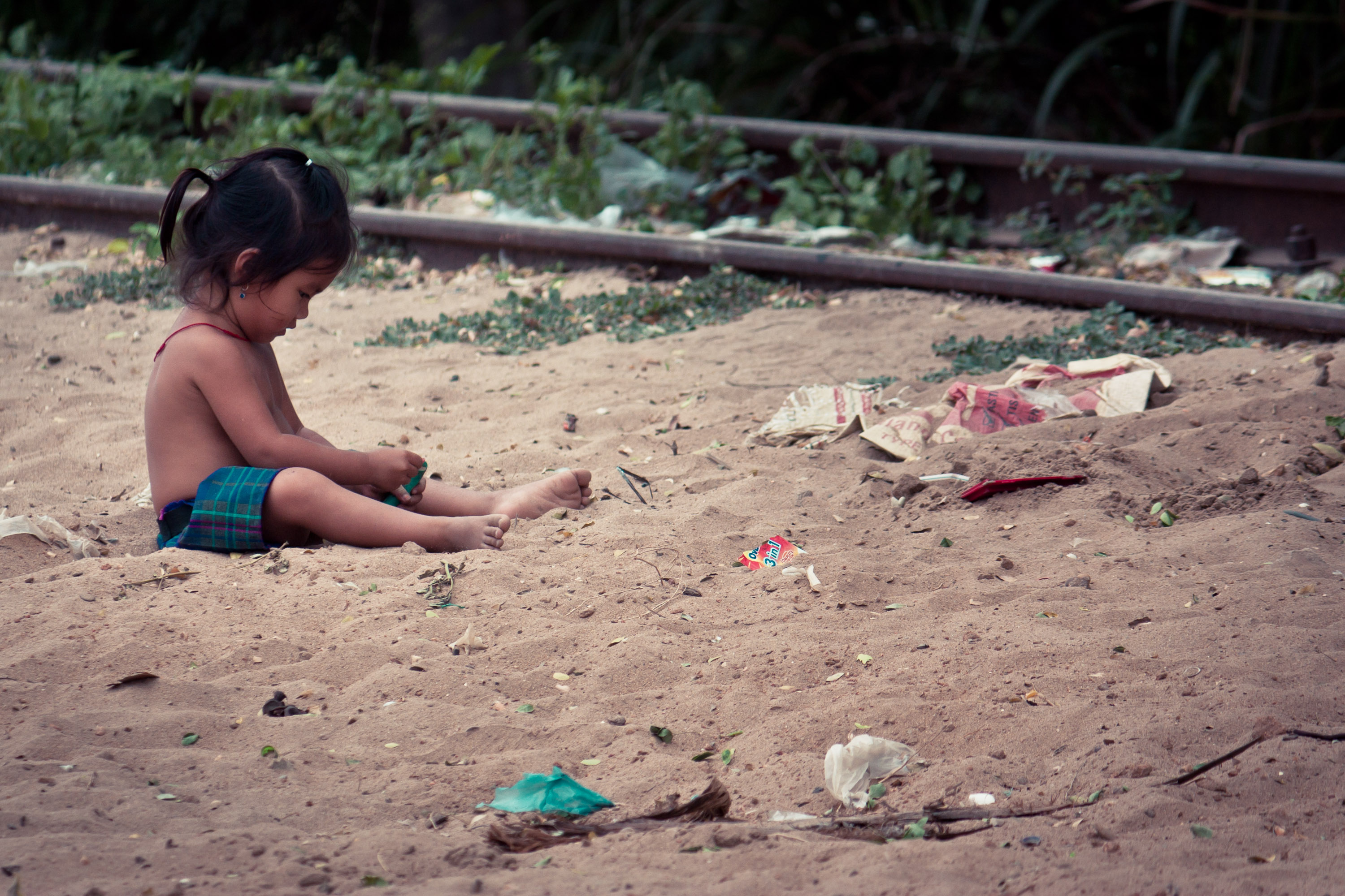 Little Cambodian Girl Plays with Bubbles
