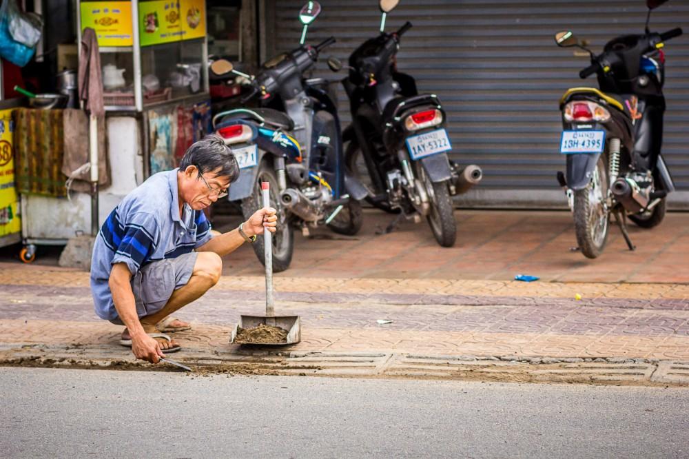 man-cleans-driveway-phnom-penh-cambodia-2407-1000x666.jpg